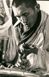 (13305_pr-2.psd) Lama Zopa Rinpoche doing puja (spiritual practice) during the Fourth Meditation Course, Kopan Monastery, Nepal, 1973. Photo by Brian Beresford.