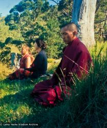 (13330_pr-2.psd) Lama Yeshe, Beatrice Ribush, and Lama Zopa Rinpoche in meditation. On Saka Dawa (the celebration of Buddha's birth, enlightenment, and death), Lama Yeshe asked everyone to come outside after a Guru Puja for a meditation on the hill behind the gompa. Chenrezig Institute, Australia, May 25, 1975. Photo by Wendy Finster.