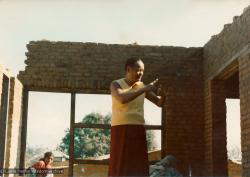 (13533_pr3.psd) Lama Yeshe supervising the construction of an addition above the