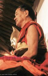 (13550_sl-3.JPG) Lama Yeshe (with statue of Lama Tsongkhapa in background) teaching the Yogas of Naropa at Istituto Lama Tzong Khapa, 1982. Dieter Kratzer (photographer)