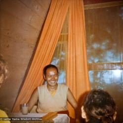 (15070_pr-1.psd) Lama Yeshe with students in an A-frame cabin at Tushita Meditation Center, Dharamsala, India, 1970.