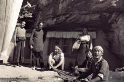 (15078_ng-2.psd) Lama Yeshe, Robert and Jesse Sternfield, and Tsultrim Allione with workers outside of the cave of the Lawudo Lama,  Lawudo Retreat Centre, 1970. Photo by Terry Clifford.