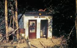 "(15187_pr.psd) The outhouse labeled Sam-Sara at Kopan Monastery, Nepal, 1973. A pun on the sanskrit term ""samsara"" which refers to the beginningless, recurring cycle of death and rebirth fraught with suffering. Photo by Lynda Millspaugh."