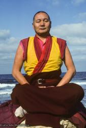 Lama Yeshe meditating by the ocean, Sicily, 1983. Photo: Jacie Keeley