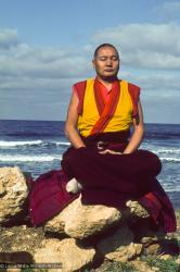 Lama Yeshe meditating by the ocean, Sicily, 1983. (Photo Jacie Keeley)