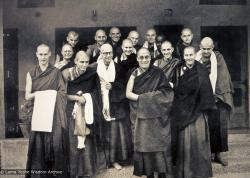 (15367_ud-2.psd) Newly ordained monks and nuns have an audience with H.H. Dalai Lama, Dharamsala, India, March 12, 1975. In the front row is Jhampa Zangpo (Mark Shaneman), Suzanne Lee (Jampa Chozom), Piero Cerri, Dieter Kratzer, Thubten Chokey, HH Dalai Lama, Gareth Sparham, Bonnie Rothenberg, John Feuille. Back row is Steve Malasky (Steve Pearl), Nick Ribush, Thubten Pende (Jim Dougherty), Jeffery Webster, Bruno LeGuevel, Jampa Konchog (Yogi), and Bonnie Rothenberg.