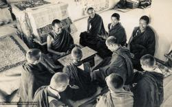 (15484_pr.psd) Lama Yeshe, Lama Zopa Rinpoche, Lama Lhundrup, and Lama Pasang with new monastics including Nick Ribush and Yeshe Khadro (Marie Obst) in the gompa (shrineroom) at Kopan Monastery, Nepal, 1974.
