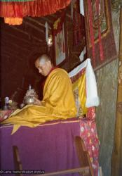 (15600_pr.tif) Lama Zopa Rinpoche doing a mandala offering. Photo from the 8th Meditation Course at Kopan Monastery, Nepal, 1975.