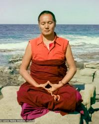 (15849_ng.tif) Lama meditating by the ocean, Maroochydore, Australia, 1974. The lamas took a day off during the Diamond Valley course to go to the beach in Tom Vichta's van. Everyone got out to enjoy the view from the cliffs, but Lama Yeshe ran straight down to the water's edge, hitched up his robes, and waded in, splashing about with delight.