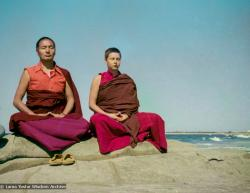 (15850_ng.tif) Lama and Yeshe Khadro meditating by the ocean, Maroochydore, Australia, 1974. The lamas took a day off during the Diamond Valley course to go to the beach in Tom Vichta's van. Everyone got out to enjoy the view from the cliffs, but Lama Yeshe ran straight down to the water's edge, hitched up his robes, and waded in, splashing about with delight.
