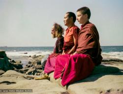 (15851_ng.tif) Lama Yeshe with Yeshe Khadro and Chamba Lane meditating by the ocean, Maroochydore, Australia, 1974. The lamas took a day off during the Diamond Valley course to go to the beach in Tom Vichta's van. Everyone got out to enjoy the view from the cliffs, but Lama Yeshe ran straight down to the water's edge, hitched up his robes, and waded in, splashing about with delight.