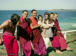 (15852_ng.tif) Group photo by the ocean, Maroochydore, Australia, 1974. The lamas took a day off during the Diamond Valley course to go to the beach in Tom Vichta's van. Everyone got out to enjoy the view from the cliffs, but Lama Yeshe ran straight down to the water's edge, hitched up his robes, and waded in, splashing about with delight.