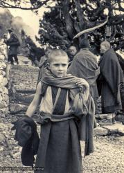 (15860_pr.psd) By 1974, Michael Losang Yeshe (Michael Cassapidis) was nine years old and had spent almost half his life at Kopan Monastery, Nepal. Here he is shown at Lawudo Retreat Center, Nepal.