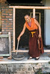 (15864_sl.tif) Lama Yeshe mixing cement for ongoing construction projects at Kopan Monastery, Nepal, 1974.