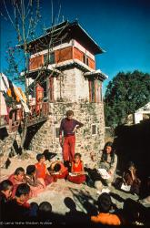 "(15866_sl.psd) Westerners teaching the Mount Everest Center students at the foot of Steve's Tower, possibly 1974. An American student, Steve Malasky (Now Steve Pearl), built a Tibetan tower at one end of the Kopan land which came to be known as ""Steve's Tower"". Kopan Monastery, Nepal, 1974"