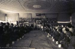 (15882_sl.psd) Photo of the lamas and sangha doing puja in the tent, Kopan Monastery, Nepal, 1974. For the Seventh Meditation Course a huge Indian wedding tent replaced the dusty burlap-walled tent.