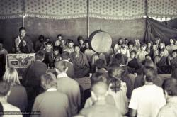 (15883_sl.psd) Photo of the lamas and sangha doing puja in the tent, Kopan Monastery, Nepal, 1974. For the Seventh Meditation Course a huge Indian wedding tent replaced the dusty burlap-walled tent.