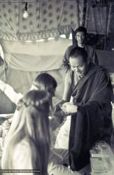 (15885_sl.psd) Lama Yeshe performing a wedding for John Morrison and Anne Ogburn in the meditation tent, Kopan Monastery, Nepal, 1974.