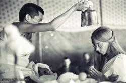 (15886_sl.psd) Lama Zopa Rinpoche blesses Anne Ogburn during a wedding in the meditation tent, Kopan Monastery, Nepal, 1974.