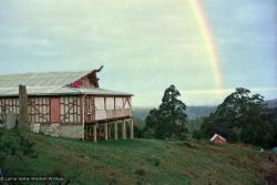 (15921_ng.psd) A rainbow over the gompa (meditation hall), Chenrezig Institute, Australia, 1975