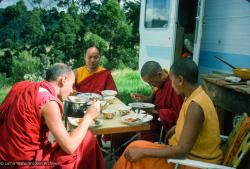 (15922_sl.tif) Lama Yeshe and Lama Zopa Rinpoche having lunch with Nick Ribush and Mummy Max, during the month-long course at  Chenrezig Institute, Australia, 1975.