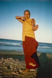 (15930_pr.psd) Lama Yeshe dancing/debating on the beach after the month-long course at Chenrezig Institute, Australia, 1975. Photo by Anila Ann.
