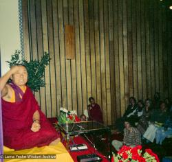 (15973_ng.tif) Lama Yeshe giving a public talk, Adyar Theater, Sydney, Australia, 8th of April, 1975.  Lama Zopa Rinpoche can be seen sitting by the wall.