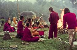 (16053_ng-2.psd) Lama Yeshe doing the Fire Puja (with Jhampa Zangpo (Mark Shaneman) holding the umbrella, Yeshe Khadro (Marie Obst) sitting to his right and Anila Ann sitting to the left, Chenrezig Institute, Australia, 1976.
