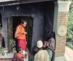 (16688_sl.tif) Adrian Feldmann (Ven Thubten Gyatso) treating local Nepali villagers outside the People's Clinic, Kopan Monastery, 1979.