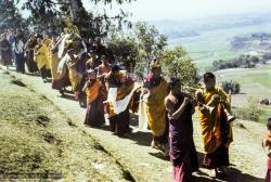 (16703_ng.tif) Lama Yeshe, Lama Zopa Rinpoche, and Yangsi Rinpoche in a procession circumambulating Kopan Monastery with the Tara statue prior to it's installation, Nepal, 1976.