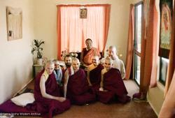 (16744_ng-3.psd) Lama Yeshe with new Sangha at rabjung ordination, Chenrezig Institute, Australia, 1976. From the left: Nigel, unknown woman,  Uldis Balodis (with beard), Charlie Topp (front center), Helen McCallum (Yeshe Dorje), and Tony Duff (right front). Behind Tony is Terry O'Neil. Lama  Yeshe is seated in the back.