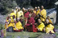 (16746_sl.psd) Ordination group with Lama Yeshe, 1976. Front row: George Churinoff (Karin Valham behind him), Elisabeth Drukier, Dieter Kratzer, (Losang Nyima behind him), Lama Yeshe, Thubten Pende (Jim Dougherty), Steve Malasky (Steve Pearl). Gareth Sparham and Marcel Bertels are behind Pende and Steve. Back row (standing): Margaret McAndrew, Adrian Feldmann (Thubten Gyatso), Scott Brusso, Ursula Bernis, Wendy Finster, unknown tibetan monk, in back Angeles de la Torre, Jeffery Webster, unknown tibetan monk, Peter Kedge, Roger Wheeler, John Feuille.