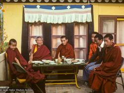 (16749_sl.TIF) Yangsi Rinpoche, Geshe Legden, and Lama Zopa Rinpoche (with Lama Lhundrup at the right) on the  rooftop terrace, Kopan Monastery, Nepal, 1977.Before Yangsi Rinpoche and his brother, Losang Tseten, left Kopan for Sera Monastery, Geshe Ngawang Legden, the Sera Jé abbot, came to visit Kopan with some monastery officials in order to thank Lama for his large donation to the Assembly Hall fund.