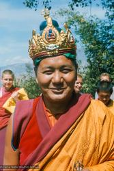 (16769_sl.tif) Lama Yeshe wearing a ceremonial crown of the five dhyani buddhas for the Tara statue procession, Kopan Monastery, Nepal, 1976. Behind him is Yeshe Khadro (Marie Obst) on the left and Wendy Finster and  Ngawang Khyentse on the right.