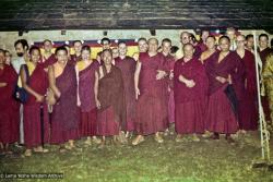 """(16773_sl-3.psd) Group photo from the consecration of Inji Gompa, including from the left: Margaret McAndrew, Ven. Nawang, Nick Ribush, Losang Gyeltsen, Bonnie Rothenberg (Konchog Donma or KD), Ani Jenni, Angeles de la Torre, Spring Chokyi Livingston, Ani Ursula,  Tsenshab Serkong Rinpoche, Jeffrey Webster, Geshe Dhargyey, Mike Lewis, Glen Mullins, Geshe Jampa Tegchok, Dieter Kratzer, and Elizabeth Drukier. In 1976, the Sangha set about rebuilding some property in McLeod Ganj for retreat purposes which they dubbed """"Inji Gompa."""" (""""Inji"""" is a Tibetan slang word for all westerners irrespective of their country of origin.)"""