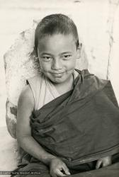 "(16778_pr.psd) Thubten Lodro, a Mount Everest Center novice, Kopan Monastery, Nepal, 1976. Lama Yeshe sent photos of the MEC students all around the world and also took photos with him on tour in an attempt to raise funds for them. ""Mummy"" Max Mathews had a photo taken of each of them and had a group photo made into a poster."