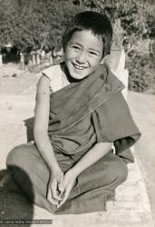 "(16779_pr.psd) A Mount Everest Center novice, Kopan Monastery, Nepal, 1976. Lama Yeshe sent photos of the MEC students all around the world and also took photos with him on tour in an attempt to raise funds for them. ""Mummy"" Max Mathews had a photo taken of each of them and had a group photo made into a poster."