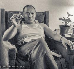 Lama Yeshe holding Tara statue, UCSC (University of Calif. at Santa Cruz), 1978. Photo by Jon Landaw.