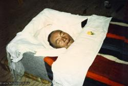 (17364_pr.jpg) Lama Yeshe in his casket. A cycle of pujas were done for Lama Yeshe before the formal cremation, Vajrapani Institute, California, 1984. Photo by Ricardo de Aratanha.