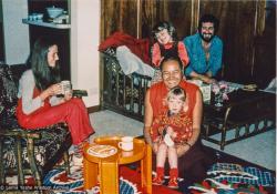 (18895_pr-3.psd) Lama Yeshe at home with the Feldmanns, Melbourne, AU, 1979. Lila Feldmann is on Lama's knee. Rita Feldmann (donor)