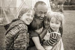 (20893_ng-1.psd) Lama Yeshe with children, Festival Day at Manjushri Institute, 1979. Brian Beresford (photographer)