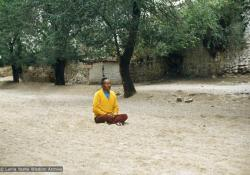 Lama Yeshe meditating at the site of his old room, Sera Monastery, Tibet, 1982.