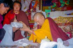 (21772_pr.jpg) Lama Zopa Rinpoche making Mandala offering, 1990. Photo by Merry Colony.
