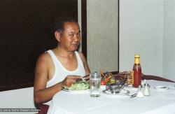 (22226_ng-3.psd) Lama Yeshe eating lunch, Hong Kong, 1982.
