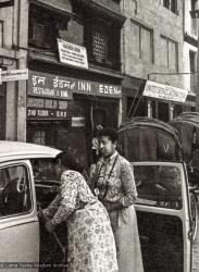 (15071_ng-2.psd) Max Mathews and her Volkswagen outside Eden Hash Shop in Kathmandu, Nepal, 1970. Another nearby hot spot was a cafe called The Blue Tibetan where Lama Yeshe sometimes went for tea and to practice his hippie English.