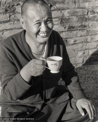 (23233_ng-3.psd) Lama Yeshe having tea at Kopan Monastery, Nepal, 1978.