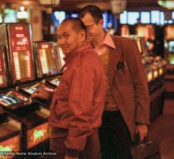 (23352_ng-3.psd) Lama Yeshe with John Feuille, playing the slots, Reno, Nevada, 1980.