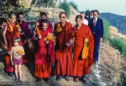 (24188_sl-3.psd) Lama Yeshe with Losang Tsultrim Geshe, His Holiness and entourage arriving at O Sel Ling. In September of 1982, H.H. Dalai Lama visited this retreat center that the lamas had just set up in Bubion, a small town near the Alpujarra mountains near Granada, Spain. At the end of the visit His Holiness gave the center its name, O Sel Ling.