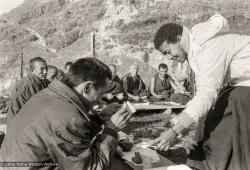 (25211_ng-3.TIF) Max serving Rinpoche after Christmas puja, Kopan Monastery, 1972.