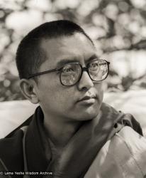 Lama Zopa Rinpoche teaching outdoors at Manjushri London (currently Jamyang Buddhist Centre), 1983. Photo by Robin Bath